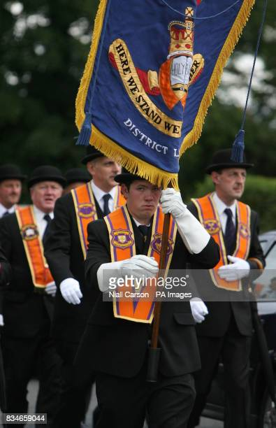 Portadown Orange man march towards Drumcree Parish Church as the lodge is prevented from marching down the nationalist Garvaghy road