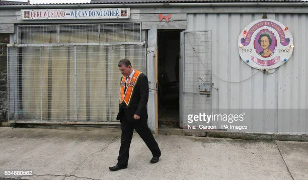 A Portadown Orange man stands outside Drumcree parish Church as the lodge is prevented from marching down the nationalist Garvaghy road
