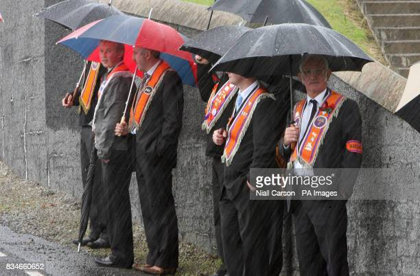 Portadown Orange men stands outside Drumcree parish Church as the lodge is prevented from marching down the nationalist Garvaghy road