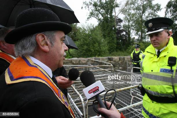 Portadown Orange order spokesman David Jones protests to a police officer as the lodge is prevented from Marching down the nationalist Garvaghy road
