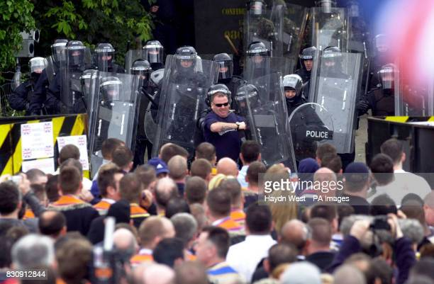 Portadown Orangemen are held back by riot police at Drumcree Portadown in Northern Ireland following their Sunday church service * Trouble erupted at...