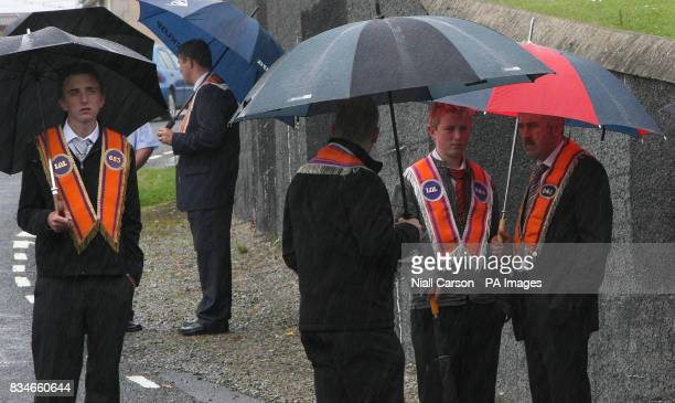 Portadown Orangemen gather outside Drumcree parish Church as the lodge is prevented from Marching down the nationalist Garvaghy road