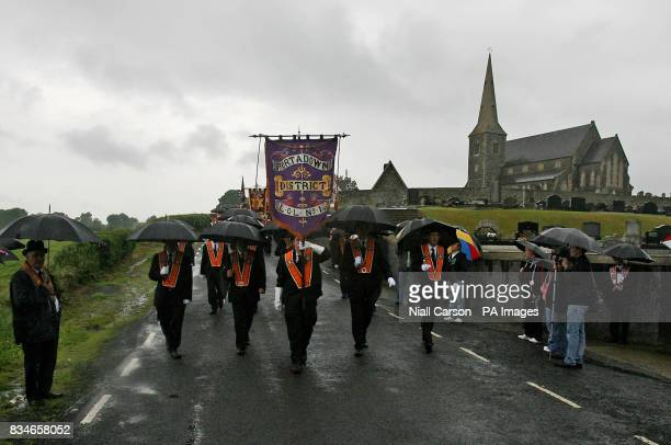 Portadown Orangemen march past Drumcree parish church as the lodge is prevented from Marching down the nationalist Garvaghy road