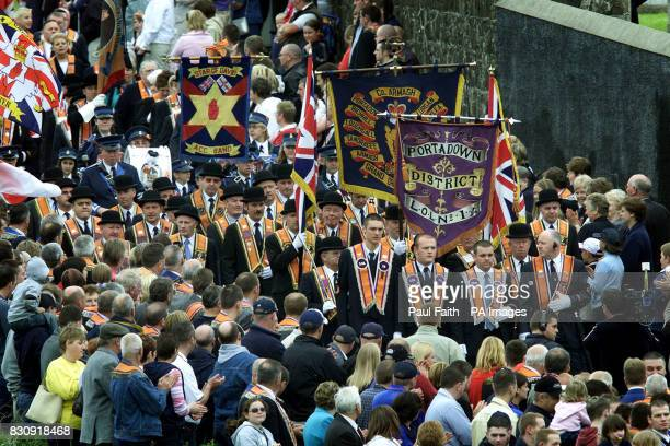 Portadown Orangemen march towards waiting police at Drumcree bridge in Northern Ireland following their Sunday church service Police and soldiers...