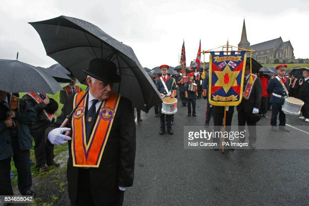Portadown Orangemen stand in front of Drumcree church as the lodge is prevented from Marching down the nationalist Garvaghy road