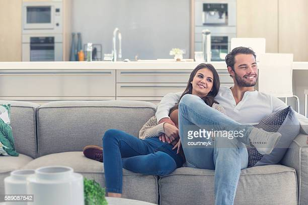 Portait of couple relaxing on the sofa.