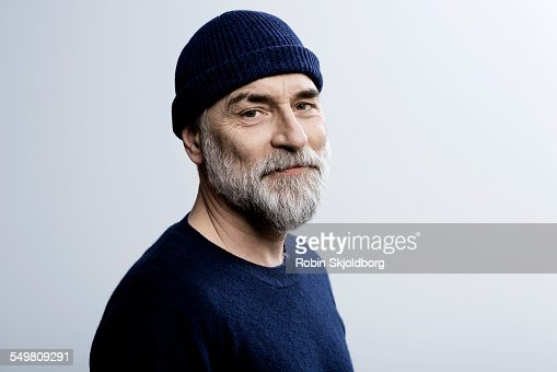 Portait of grey haired man wearing hat