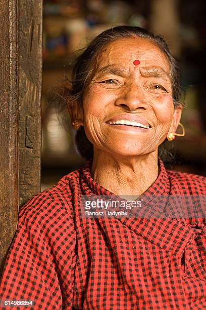 Portait of happy Nepali woman in Bhaktapur near Kathmandu