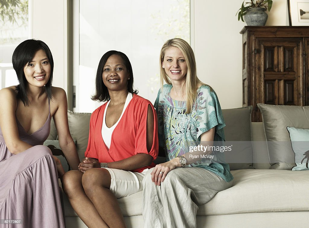 Portait of three women sitting on sofa : Stock Photo