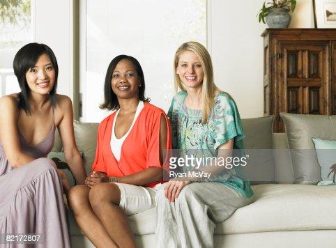 Portait of three women sitting on sofa : Stock Photo