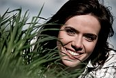 Portait of young woman in grass