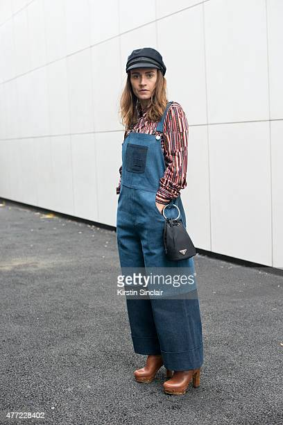 Portemento Store founder Sara Reverberi wears Fleamadonna dungarees Prada bag vintage shirt and Portemento Store shoes on day 3 of London Collections...