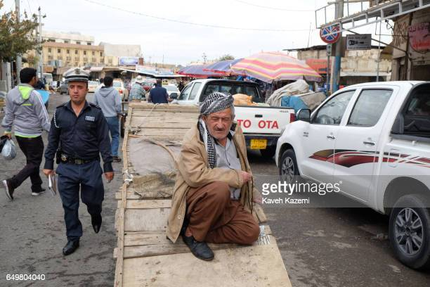 A porter rests on his push cart in the market near the citadel on November 2 2016 in Erbil Iraq Erbil also spelt Arbil or Irbil is the capital city...