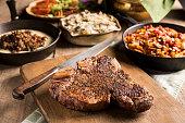 Porterhouse Steak with Sweet Potato Casserole and Creamed Collard Greens