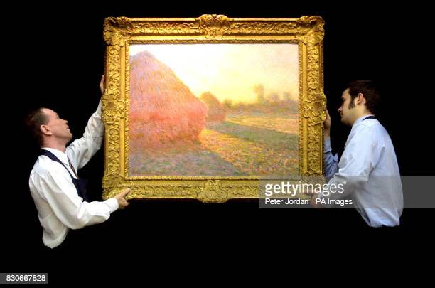 Porters hang 'Haystacks' a painting by Monet not seen publicly since 1895 and is expected to fetch between 57 million when it goes under the hammer...