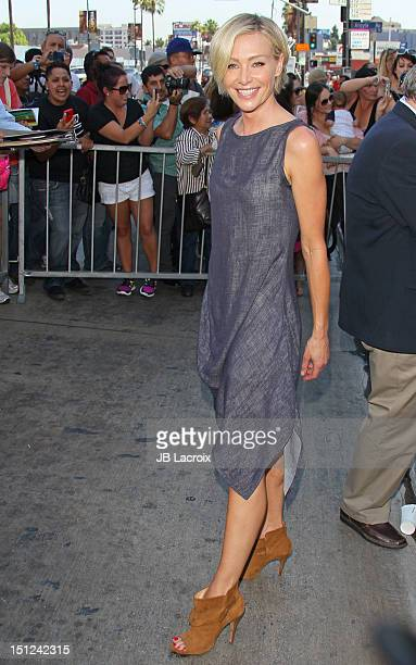 Portia de Rossi attends Ellen DeGeneres's induction into the Hollywood Walk of Fame on September 4 2012 in Hollywood California