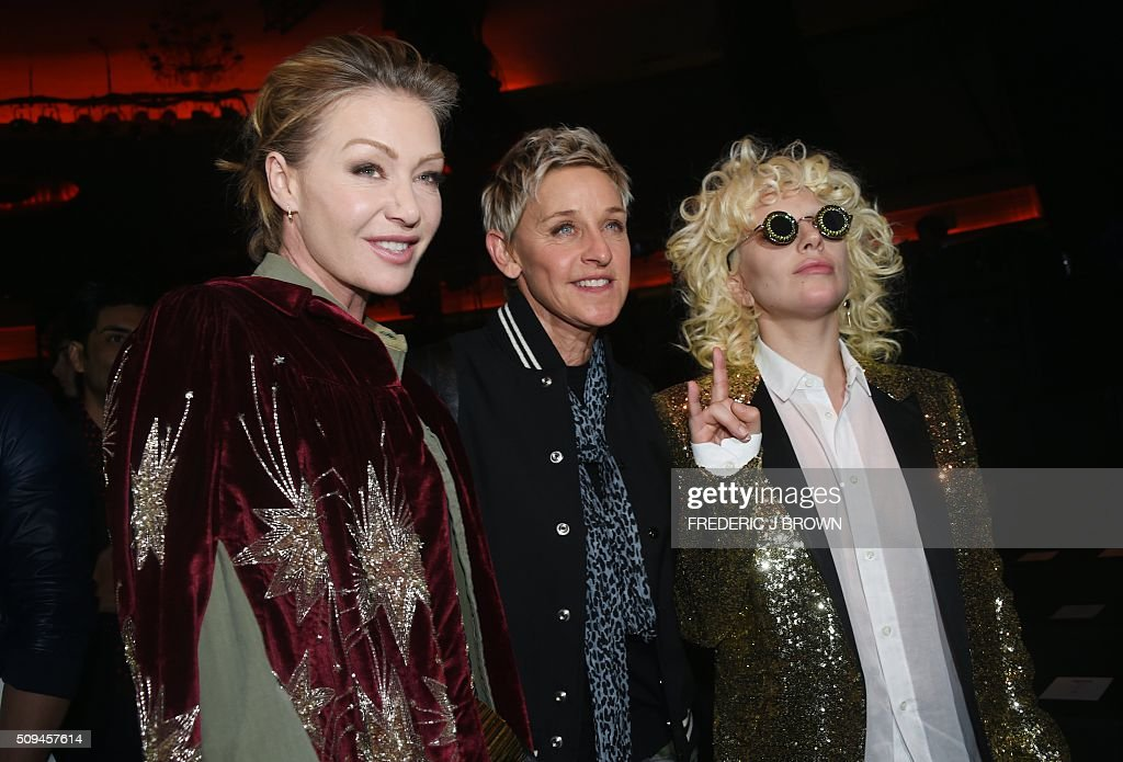 Portia de Rossi (L), Ellen DeGeneres (C) and Lady Gaga attend the Yves Saint Laurent men's fall line and the first part of its women's collection fashion show at the Paladium, in Hollywood, California, February 10, 2016. / AFP / FREDERIC J BROWN