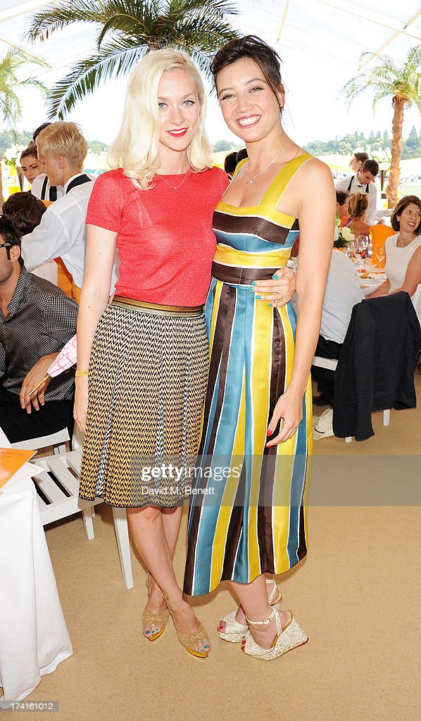 Portia Freeman (L) and Daisy Lowe attend the Veuve Clicquot Gold Cup Final at Cowdray Park Polo Club on July 21, 2013 in Midhurst, England.
