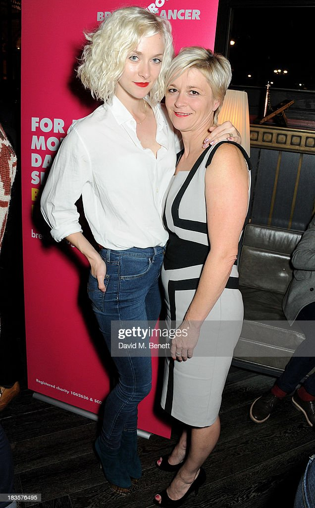 <a gi-track='captionPersonalityLinkClicked' href=/galleries/search?phrase=Portia+Freeman&family=editorial&specificpeople=2348960 ng-click='$event.stopPropagation()'>Portia Freeman</a> (L) and mother Liz Stone attend the 'Models & Mothers' private view, an exhibition of photographs by Morwenna Lytton Cobbold, at The Gilbert Scott restaurant in the St Pancras Renaissance Hotel on October 7, 2013 in London, England.