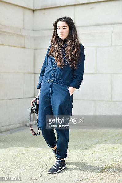 Portia Hunt poses wearing a Topshop jumpsuit and Nike shoes on Day 5 of Paris Fashion Week Womenswear FW15 on March 7 2015 in Paris France