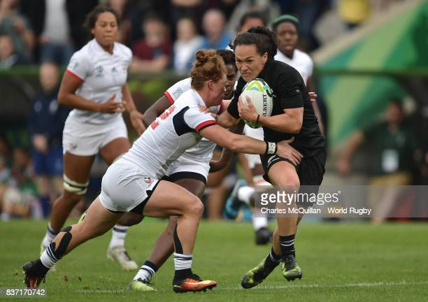 Portia Woodman of New Zealand hands off Alev Kelter of the United States enroute to scoring her team's second try during the Women's Rugby World Cup...