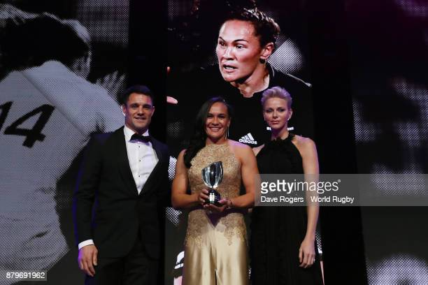 Portia Woodman of New Zealand receives the poses with the World Rugby Women's Player of the Year Award in association with Mastercard from Dan Carter...