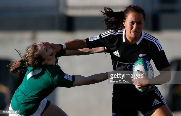 Portia Woodman of New Zealand stiff arms Aoife Doyle of Ireland during the IRB Women's Sevens World Series at Fifth Third Bank Stadium on February 15...