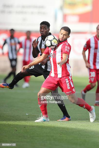 Portimonense forward Wilson Manafa from Portugal vies with Aves defender Rodrigo Soares from Brasil for the ball possession during the match between...