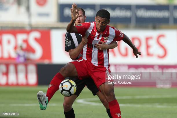 Portimonense midfielder Oriol Rosell from Spain vies with Aves midfielder Washington from Brazil for the ball possession during the match between...