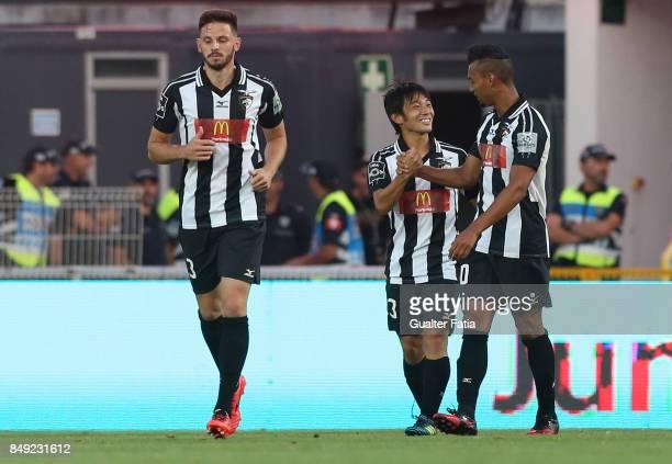 Portimonense SC forward Shoya Nakajima from Japan celebrates with teammate Portimonense SC midfielder Fabricio Messias from Brazil after scoring a...