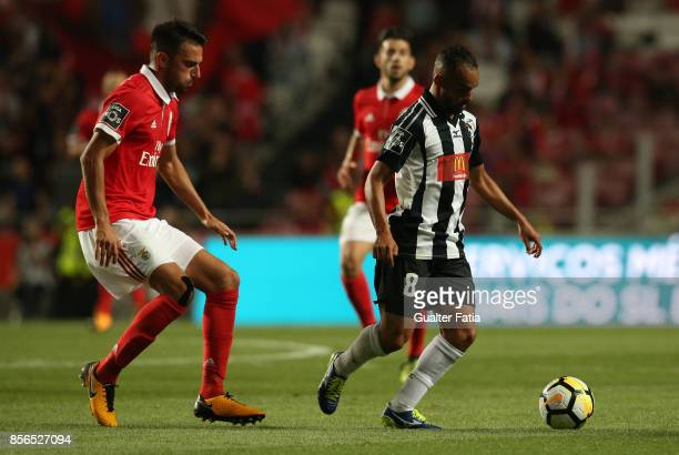 Portimonense SC midfielder Paulinho from Brazil with SL Benfica midfielder Andreas Samaris from Greece in action during the Primeira Liga match...