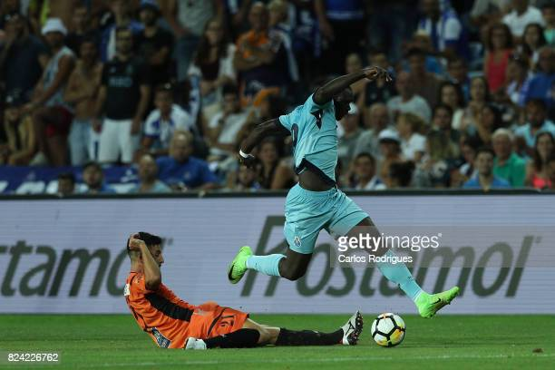Portimonense SC midfielder Pedro Sa from Portugal tries to stop FC Porto forward Vincent Aboubakar from Cameroon during the PreSeason Friendly match...