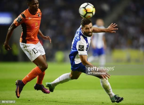 Portimonense's Brazilian defender Felipe Macedo vies with Porto's Brazilian defender Felipe during the Portuguese league football match FC Porto vs...