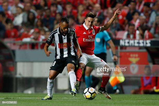 Portimonense's midfielder Paulinho vies for the ball with Benfica's midfielder Franco Cervi during Primeira Liga 2017/18 match between SL Benfica vs...