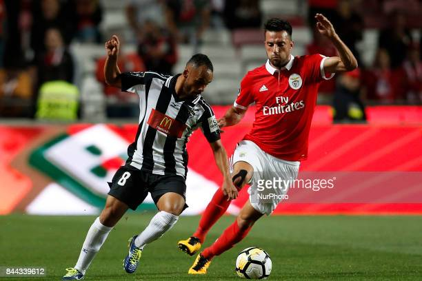 Portimonense's midfielder Paulinho vies for the ball with Benfica's midfielder Andreas Samaris during Primeira Liga 2017/18 match between SL Benfica...
