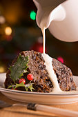 Portion of Christmas Pudding with Cream