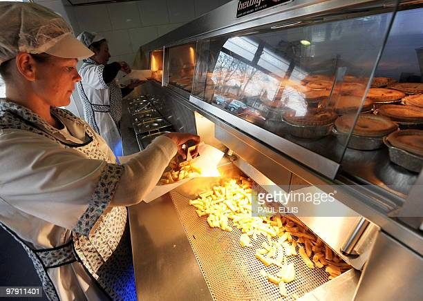 A portion of fish and chips is served at a Fish and Chip Takeaway in Manchester northwest England on March 10 2010 Whether wrapped in newspaper and...
