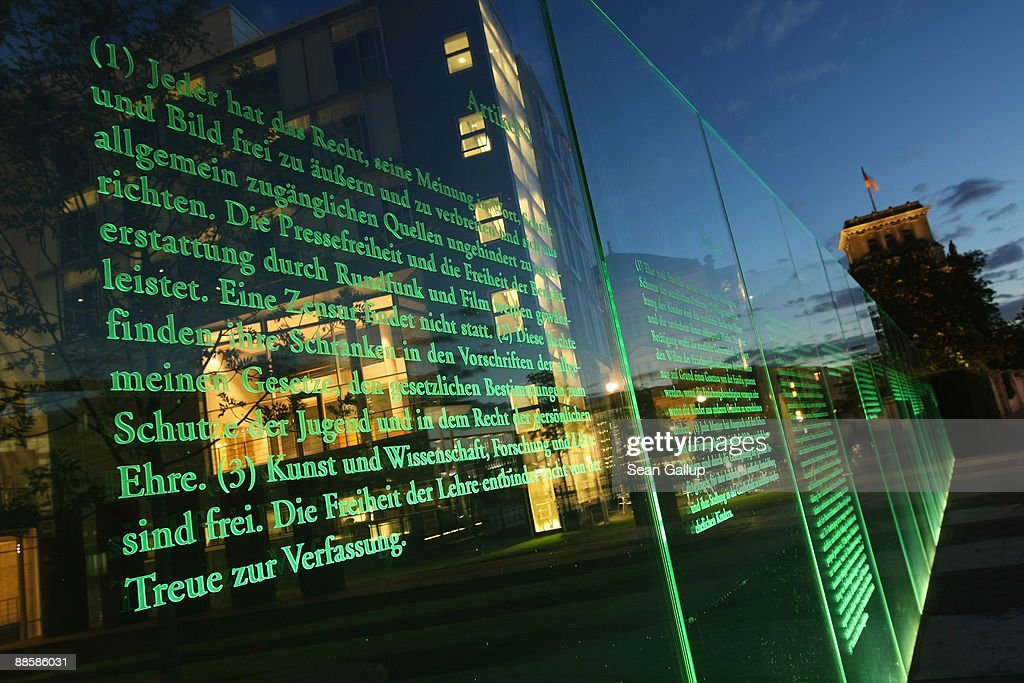 A portion of Germany's post-World War II constitution (Grundgesetz) stands illuminated in a permanent display near the Reichstag on land that was once behind the Iron Curtain on June 19, 2009 in Berlin, Germany. On November 9 Germany will commemorate the 20th anniversary of the fall of the Berlin Wall, and will hold a series of events leading up to it to raise historical awareness.