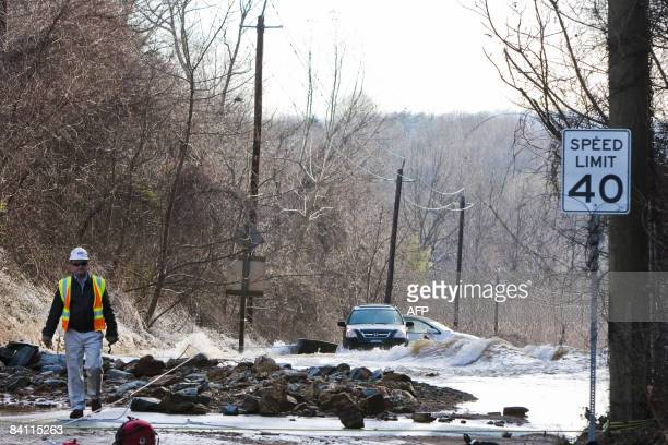 A portion of road washed out by a flood on December 23 2008 caused by a water main break on River Road in Montgomery County near Bethesda A 5andhalf...