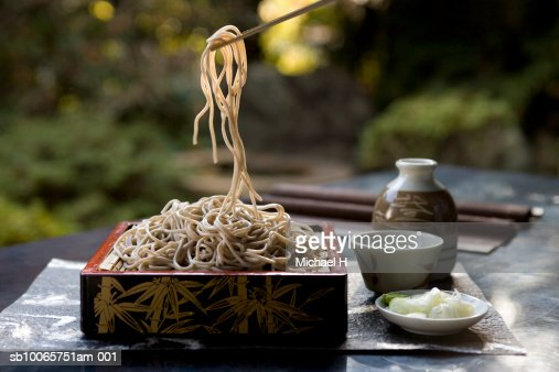 Portion of Soba noodles being taken from plate