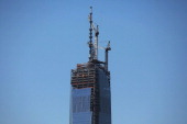 A portion of the 408foot spire is seen after the last 75foot section was hoisted onto a temporary platform on the top of One World Trade Center on...