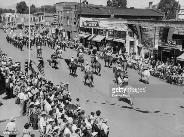 A portion of the thousands who gathered to watch the Stampede parade is shown here on Monte Vista's main street Parades held all three days of the...