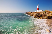 The Portland Bill Lighthouse on the Isle of Portland in Dorset, England on a sunny day.
