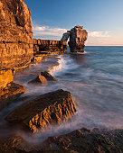 The waves crash over the rocks at Portland Bill, Dorset, UK