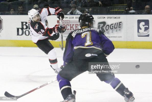 Portland Brett Hextall takes a shot as Manchester Andrew Bonardchuck watches at the end of the first period at Pirates vs Manchester Monarchs Tuesday...