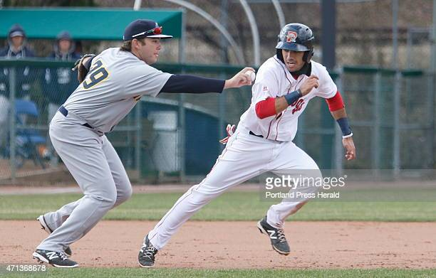 Portland Carlos Asuaje is tagged out during a rundown by Trenton Dante Bichette Jr during the sixth inning Portland Sea Dogs vs Trenton Thunder at...