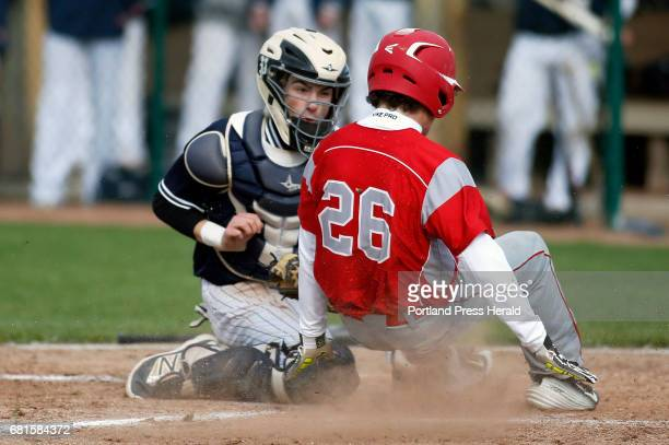 Portland catcher Camren King makes the play at home plate tagging out South Portland's Gordon Whittemore