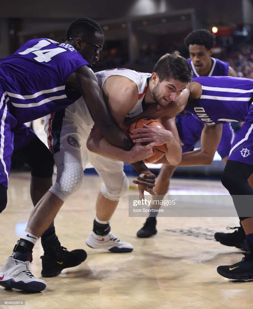 Portland forward Tahirou Diabate (left) and guard Marcus Shaver Jr. (right) tie up GU forward Killian Tillie (33) in this battle for a loose ball during the game between the Portland Pilots and the Gonzaga Bulldogs played on January 11, 2018, at McCarthey Athletic Center in Spokane, WA.
