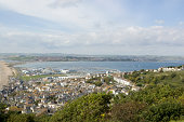 View from the heights of the Isle of Portland of harbour and Weymouth Bay.  Dorset.