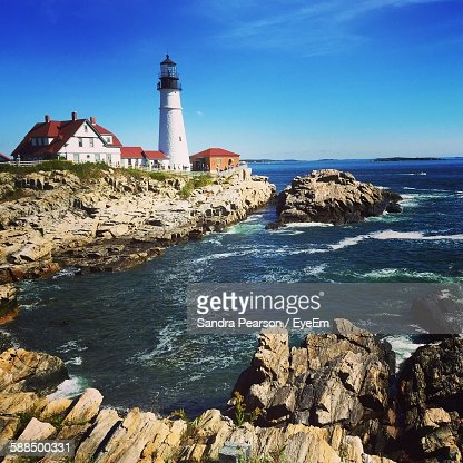 Portland Head Light By Sea Against Sky